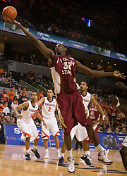 Florida State center Solomon Alabi (32) shoots a finger roll jump shot against UVA.  The Virginia Cavaliers fell to the Florida State Seminoles 73-62 in NCAA Basketball at the John Paul Jones Arena on the Grounds of the University of Virginia in Charlottesville, VA on January 24, 2009.