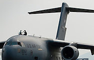 New Windsor, New York - People sit on top of a C-17 Globemaster II on display at the New York Air Show at Stewart International Airport on Aug. 30, 2015. ©Tom Bushey / The Image Works