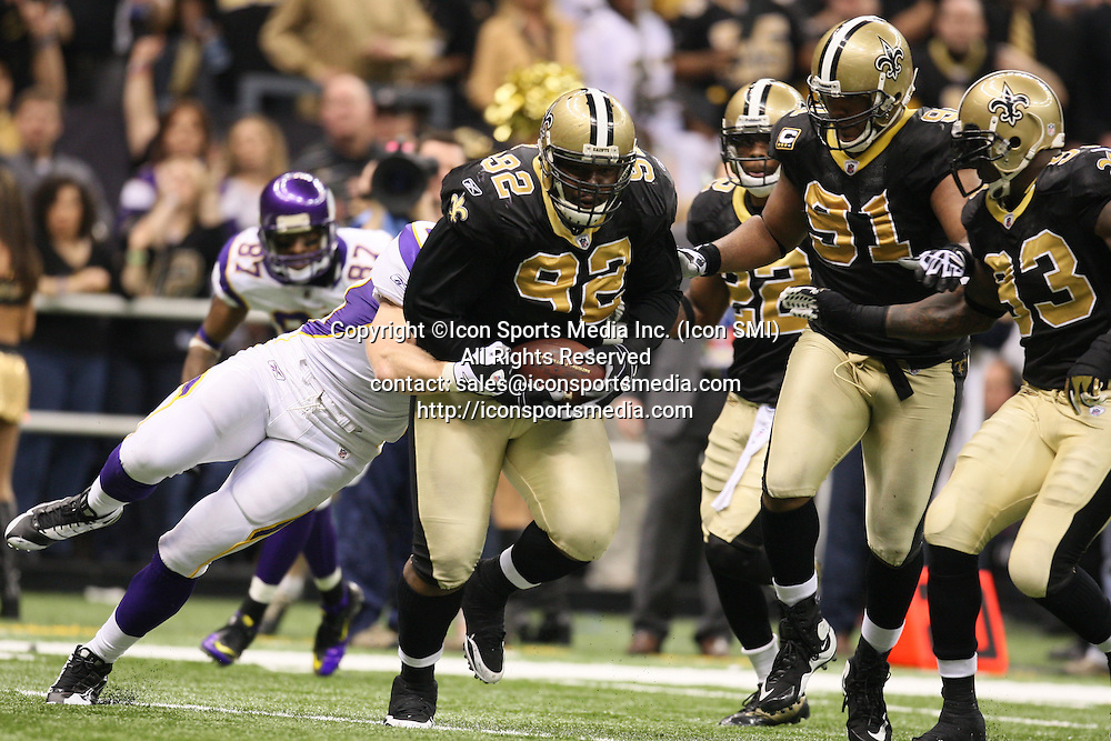 24 January 2010: New Orleans Saints defensive tackle Remi Ayodele (92) runs with the ball after recovering a fumble.  The New Orleans Saints defeated the Minnesota Vikings by a score of 31 to 28 at the Louisiana Superdome, New Orleans, LA.