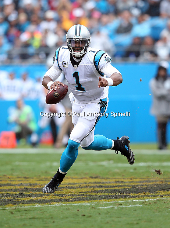 Carolina Panthers quarterback Cam Newton (1) points as he scrambles during the 2015 NFL week 3 regular season football game against the New Orleans Saints on Sunday, Sept. 27, 2015 in Charlotte, N.C. The Panthers won the game 27-22. (©Paul Anthony Spinelli)