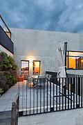 external of a modern house with veranda, evening scene