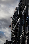 Window cleaners in a lift on the side of a modern office building in Victoria, London, UK Friday January 5th 2018
