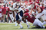 FAYETTEVILLE, AR - SEPTEMBER 5:  Aaron Jones #29 of the UTEP Miners is tackled by Jeremiah Ledbetter #55 of the Arkansas Razorbacks at Razorback Stadium on September 5, 2015 in Fayetteville, Arkansas.  The Razorbacks defeated the Miners 48-13.  (Photo by Wesley Hitt/Getty Images) *** Local Caption *** Aaron Jones; Jeremiah Ledbetter
