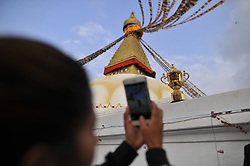 December 7, 2018 - Kathmandu, Nepal - Nepalese peope taking pictures of the Webb Elllis Rugby World Cup 2019 Trophy is pictured infront Boudhanath Stupa, UNESCO World heritages site during a country tour in Kathmandu, Nepal on Friday, December 07, 2018. The 2019 Rugby World Cup will be the ninth Rugby World Cup, and is to be hosted by Japan from 20 September to 2 November, 2019. (Credit Image: © Narayan Maharjan/NurPhoto via ZUMA Press)