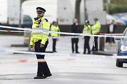 © Licensed to London News Pictures. 06/02/2019. London, UK. Police keep guard the crime scene on Westbridge Road in Battersea where a 19 year old man was fatally stabbed last night. Police have arrested two men. Photo credit: Peter Macdiarmid/LNP