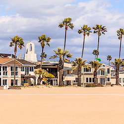 Photo of Orange County oceanfront luxury beach homes in Newport Beach California. Newport Beach is a wealthy beach city along the Pacific Ocean in Southern California.