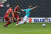 Milton Keynes Dons Jordan Moore-Taylor(15) trips Forest Green Rovers George Williams(11) for a penalty during the EFL Sky Bet League 2 match between Milton Keynes Dons and Forest Green Rovers at stadium:mk, Milton Keynes, England on 15 September 2018.