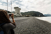 A turist taking pictures of the border building between Georgia and Turkey in Serpi