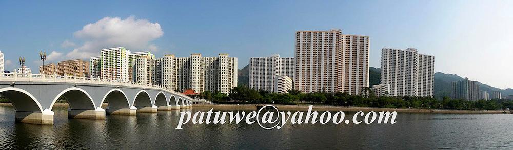Sha Tin public housing estate with Lek Yuen bridge connected between Shing Mun river, Hong Kong, China.