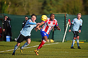 Dorking Wanderers Jerome Beckles and Lewes FC Ronnie Conlon in action during the Ryman League - Div One South match between Dorking Wanderers and Lewes FC at Westhumble Playing Fields, Dorking, United Kingdom on 28 January 2017. Photo by Jon Bromley.