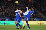 Dele Alli of Tottenham (20) gets stuck in to the action in the opening minutes with Leicester City forward Shinji Okazaki (20) and Leicester City midfielder Wilfred Ndidi (25) during the Premier League match between Leicester City and Tottenham Hotspur at the King Power Stadium, Leicester, England on 28 November 2017. Photo by Jon Hobley.