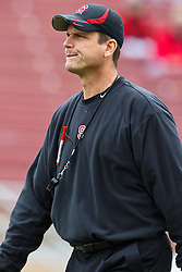 October 23, 2010; Stanford, CA, USA;  Stanford Cardinal head coach Jim Harbaugh watches his team before the game Washington State Cougars at Stanford Stadium.