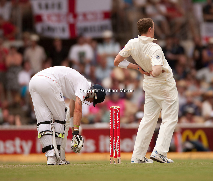 Kevin Pietersen struggles with his leg as bowler Peter Siddle has back problems during his double century in the second Ashes Test Match between Australia and England at the Adelaide Oval. Photo: Graham Morris (Tel: +44(0)20 8969 4192 Email: sales@cricketpix.com) 5/12/10
