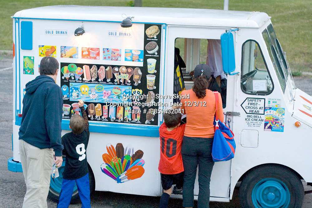 Children with parents patronizing a mobile ice cream truck. St Paul Minnesota MN USA