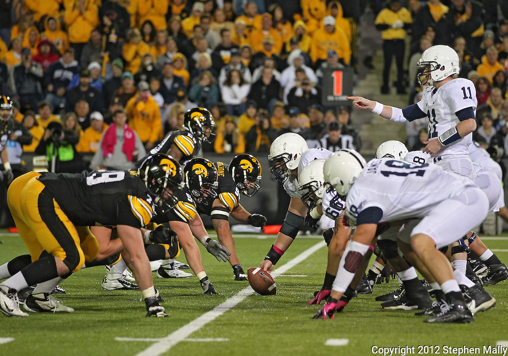 October 20 2012: Penn State Nittany Lions quarterback Matthew McGloin (11) points to the defense before a snap during the second half of the NCAA football game between the Penn State Nittany Lions and the Iowa Hawkeyes at Kinnick Stadium in Iowa City, Iowa on Saturday October 20, 2012. Penn State defeated Iowa 38-14.