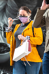 © Licensed to London News Pictures. 12/03/2020. London, UK. A Train traveller at Victoria Station wears a mask as the World Health Organization declares Covid19 the Coronavirus disease a Pandemic and US President Donald Trump bans all travel from Europe except from UK as fears over the Coronavirus continues. Photo credit: Alex Lentati/LNP