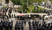The flag-draped casket of Jersey City Mayor Glenn Cunningham is brought out of City Hall followed by a procession. Cunningham was a former police officer and the first African American mayor of New Jersey's largest city.