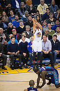 Golden State Warriors guard Stephen Curry (30) shoots a three pointer as Charlotte Hornets forward Marvin Williams (2) struggles to stay on his feet at Oracle Arena in Oakland, Calif., on February 1, 2017. (Stan Olszewski/Special to S.F. Examiner)
