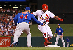 September 26, 2017 - St Louis, MO, USA - The St. Louis Cardinals' Tommy Pham is picked off first base as Chicago Cubs first basman Anthony Rizzo (44) applies the tag to end the sixth inning on Tuesday, Sept. 26, 2017, at Busch Stadium in St. Louis. The Cards won, 8-7. (Credit Image: © Chris Lee/TNS via ZUMA Wire)