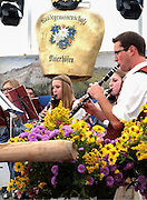 "Town musicians in Maierhöfen, Germany, entertain at this year's viehscheid hosted by the ""weidegenossenschaft"" – pasture cooperative. Local asters, coreopsis and goldenrod take the stage too."