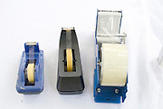 Clear scotch tape dispensers at vendors booth. Dragon Festival Lake Phalen Park St Paul Minnesota USA