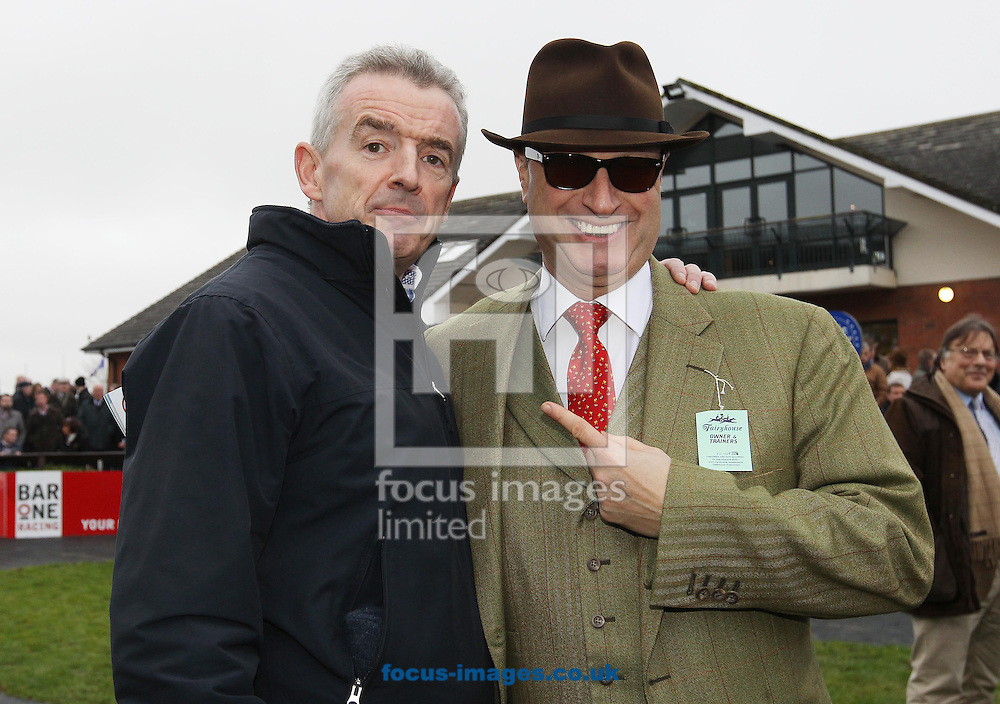 Michael O'Leary owner of Lieutenant Colonel celebrates winning the Hattons Grace Hurdle with Rich Richie owner of Zaidpour (a faller n the race) at Fairyhouse Racecourse, Ratoath<br /> Picture by Lorraine O'Sullivan/Focus Images Ltd +353 872341584<br /> 30/11/2014