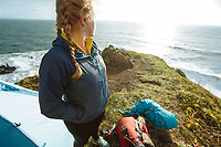 Young woman camping along the Oregon Coast Trail.