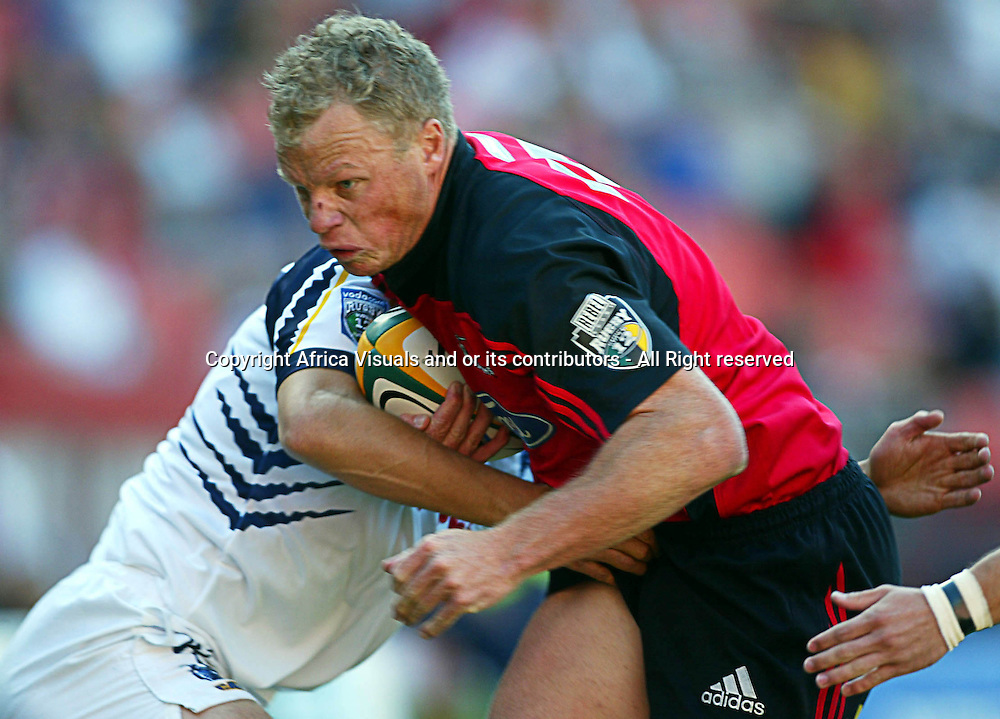 17 April, 2004. Rugby Union Super 12. Ellis Park, Johannesburg, South Africa. Cats vs Crusaders. Scott Hamilton attacks towards the line. The Crusaders won the match 39-37, with a last minute penalty conversion.<br /> Pic: Photosport