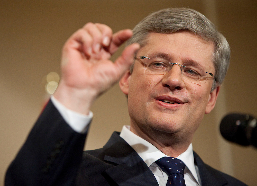 Prime Minister Stephen Harper speaks to the media at a press conference in Calgary, Alberta, May 3, 2011 following the election of a Conservative majority government in the federal election yesterday. <br /> AFP/GEOFF ROBINS/STR