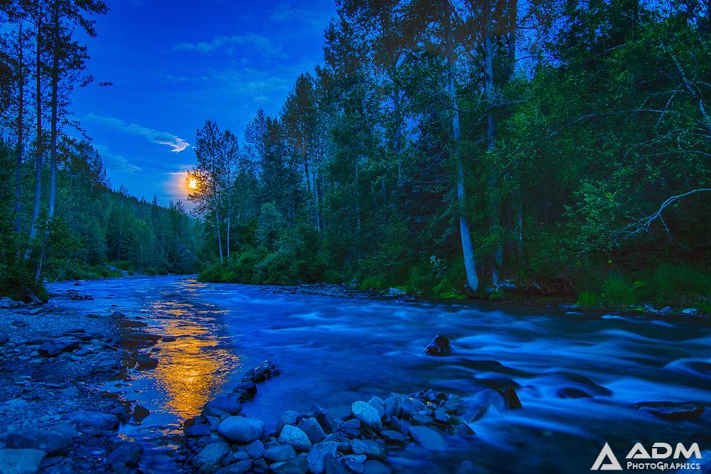 Moon rises over Resurrection River, near Hope, Alaska, summer, night