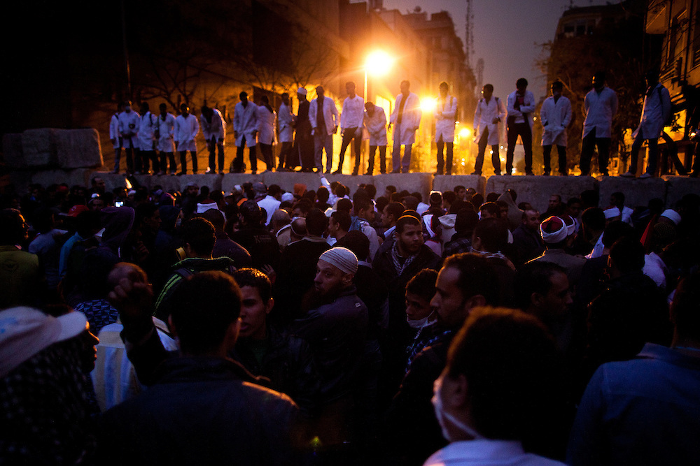 November 23, 2011 – Cairo, Egypt – Doctors, protesters and Islamists block access to Mohamed Mahmoud Street, scene of repeated fighting. A truce between Egyptian riot police and protesters succeeded on Thursday in calming violence that has killed at least 39 people as thousands of Egyptians furious at the slow transfer of power by military leadership to civilian rule have led to a sixth day of violent clashes with police, The Egypt's ruling military council said there would be no delay to a parliamentary vote scheduled for november 28.
