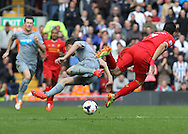 Paul Dummett of Newcastle United clashes with Luis Suarez of Liverpool, resulting in Dummett being sent off by referee Phil Dowd during the Barclays Premier League match at Anfield, Liverpool.<br /> Picture by Michael Sedgwick/Focus Images Ltd +44 7900 363072<br /> 11/05/2014