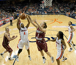 UVA's Siedah Williams (4) grabs a rebound from BC's Ayla Brown (1).  The Cavaliers defeated the Eagles 65-63 in overtime at the John Paul Jones Arena in Charlottesville, VA on January 14, 2007.