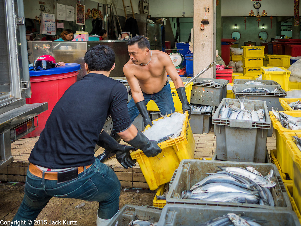 14 AUGUST 2015 - BANGKOK, THAILAND: Workers pack a truck with fresh fish in an alley next to Saphan Pla fish market in Bangkok. Saphan Pla fish market is the wholesale fish market that serves Bangkok. Most of the fish sold in Saphan Pla is farmed raised fresh water fish. The market is open 24 hours but it's busiest in the middle of the night and then again from about 7.30 until 11 in the morning.       PHOTO BY JACK KURTZ