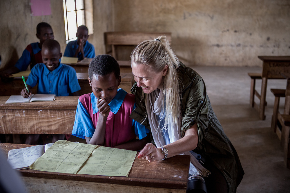 Signe, a participant on the photographic safari, sits with students at a school in Samburu