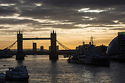 Sunrise over Tower Bridge, central London. Tower bridge has become an iconic symbol of London that crosses the river Thames.