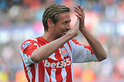 Stoke City's Peter Crouch celebrates after his side beat Liverpool 6-1 - Photo mandatory by-line: Nizaam Jones/JMP - Mobile: 07966 386802 - 24/05/2015 - SPORT - Football - Stoke - Britannia Stadium - Stoke City v Liverpool - Barclays Premier League