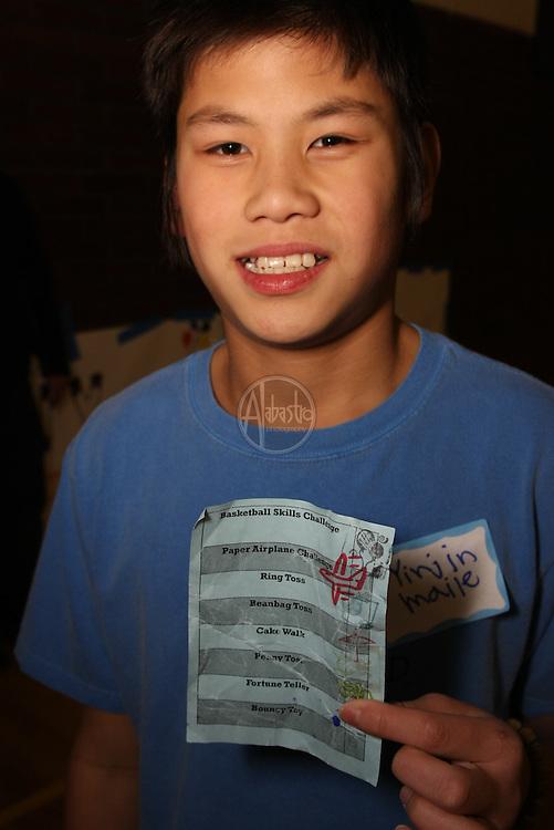Stamping passports at HIMS Carnival Night 2010 - 6th grader Yinjin Maile