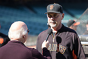 Bruce Bochy is interviewed by Jon Miller, during batting practice prior to the MLB game between the San Francisco Giants and the Colorado Rockies, at AT&amp;T Park in San Francisco, CA.<br /> The Rockies won 8-6 in 9 innings.<br /> Credit : Glenn Gervot