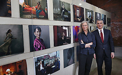 © Licensed to London News Pictures. This image is free to use ONLY in connection with the launch of the 'WOMEN: New Portraits' exhibition. 13/1/2016. London, UK. Annie Leibovitz stands with Sergio P Ermotti, Group CEO, UBS at the launch of the 'WOMEN:New Portraits' exhibition at Wapping Hydraulic Power Station. The exhibition opens to the public from Saturday 16th January until 7th February 2016. The newly commissioned photographs by the world renowned photographer will travel to 10 cities over the course of twelve months – London, Tokyo, San Francisco, Singapore, Hong Kong, Mexico City, Istanbul, Frankfurt, New York and Zurich. Access will be free to the public. Photo credit: Peter Macdiarmid/LNP