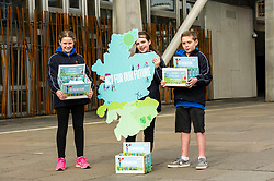 Pictured: Lucy Beeston (pony tail 11), Fay Turpie Laird (11) and Sorley Scott (10) protest for zero climate emmissions by 2050<br /> <br /> Cabinet secretary for Environment, Climate Change and Land Reform, Roseanna Cunningham, MSP, joined pupils from Sceines Primary School outside the Scottish Parliament to support the campaign to reduce climate emissions to zero by 2050<br /> <br /> <br /> Ger Harley | EEm 20 September 2017