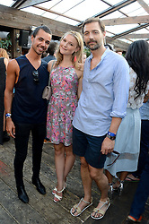 Left to right, PIERS HARGREAVES-ADAMS, AMBER ATHERTON and PATRICK GRANT attending the Warner Bros. & Esquire Summer Party held at Shoreditch House, Ebor Street, London E1 on 18th July 2013.