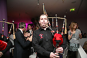 Piper from the Red hot Chili Pipers, Not Another Burns night.  Fundraising gala in aid of Clic Sargent and Children's Hospice Association Scotland (CHAS)St. Martin's Lane Hotel.  Monday 3rd March *** Local Caption *** -DO NOT ARCHIVE-© Copyright Photograph by Dafydd Jones. 248 Clapham Rd. London SW9 0PZ. Tel 0207 820 0771. www.dafjones.com.