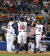 March 12, 2017 - Miami, FL, USA - United States third baseman Nolan Arenado is congratulated by teammates Christian Yelich (7) and Adam Jones (10) after hitting a three-run home run during the second inning of a World Baseball Classic first round Pool C game against Canada on Sunday, March 12, 2017 at Marlins Park in Miami, Fla. (Credit Image: © David Santiago/TNS via ZUMA Wire)