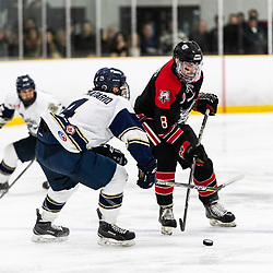 TORONTO, ON - APR 10, 2018: Ontario Junior Hockey League, South West Conference Championship Series. Game seven of the best of seven series between the Georgetown Raiders and the Toronto Patriots, Derek McVey #8 of the Georgetown Raiders and Nicolas Aromatario #4 of the Toronto Patriots battle for the puck during the third period.<br /> (Photo by Kevin Raposo / OJHL Images)