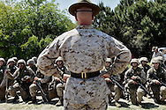 A platoon of recruits pay close attention to their drill instructor after leaving the rifle range during their second phase of training.  Marine Corps Recruit Depot at Parris Island in South Carolina is where all male recruits living east of the Mississippi River and all female recruits from all over the US receive their arduous twelve week training in their quest to become marines. Even though there are two current active wars and a weak economy, recruitment has not been effected.  Actually, recruiting numbers have increased, with more young men and women looking toward the military for answers.