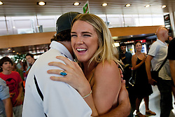 Anze Kopitar hugs Gasper Kopitar's girlfriend Kelsey Rae Braunecker at Slovenian ice-hockey player NHL Champion Anze Kopitar welcome ceremony when he arrived home after winning Stanley Cup at the end of season 2011/2012, on June 20, 2012, at airport Jozeta Pucnika, Brnik, Slovenia. (Photo By Matic Klansek Velej / Sportida)