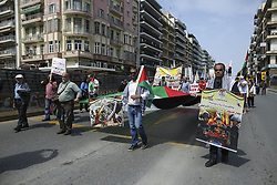 May 1, 2017 - Thessaloniki, Greece - Palestinians demonstrate during the 1st of May general strike - memorial rally in Greece for the workers rights. A group of Palestinians supported by Greek political movements, participated in the demonstration peacfully with a huge flag, songs and banner. Some of them mentioned the hunger strike other the support of Greek people to Palestine, some had written the following: ''right and equality to freedom'', ''starving for palestinian prisoners'', ''Their Freedom is our duty'' and more. (Credit Image: © Nicolas Economou/NurPhoto via ZUMA Press)