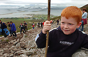 Eamonn Walsh from Derry on the ascent of Croagh Patrick in County Mayo, Ireland for the annual pilgrimage on Reek Sunday. PHoto:Andrew Downes
