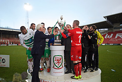 WREXHAM, WALES - Monday, May 2, 2016: FAW's Life President presents the trophy to The New Saints' goalkeeper Paul Harrison during the 129th Welsh Cup Final at the Racecourse Ground. (Pic by David Rawcliffe/Propaganda)